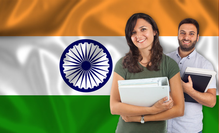 internships: Couple of young students with books over indian flag Stock Photo