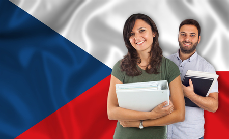 internships: Couple of young students with books over Czech Slovak flag