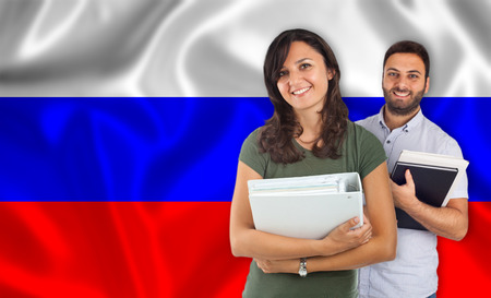 internships: Couple of young students with books over russian flag