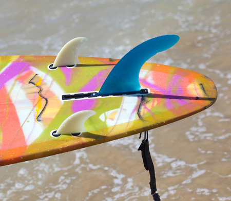 surfboard fin: Close up of fins of longboard on the beach Stock Photo