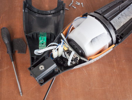 faulty: Vacuum cleaner disassembled for repair malfunctioning on work table