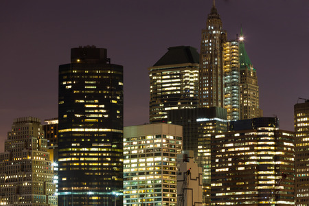 city night: Close shot of skyscrapers with lights on in the offices by night, Manhattan, New York. Stock Photo