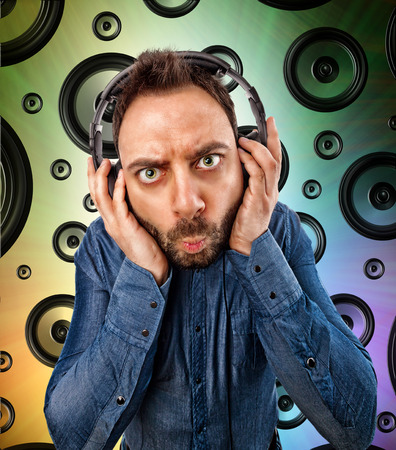 dj boy: Young man with headphones and background with speakers