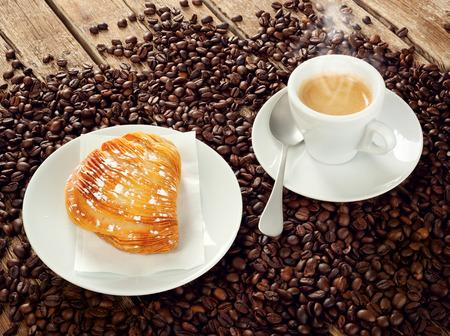 fuming: Neapolitan Sfogliatella riccia with cup of espresso coffee