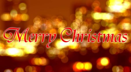 written: Merry Christmas written on blurred background with bokeh lights. Stock Photo