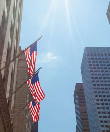 fifth: View of Fifth Avenue and American flags in New York City