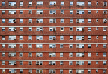 many windows: External facade of a building in New York. Many windows all identical.