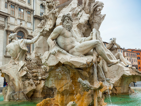 sculptures: Statue of the god Zeus in Berninis Fountain of the Four Rivers in Piazza Navona, Rome. Detail of the allegorical Ganges figure.