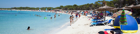 fairly: COLONIA DE SANT JORDI, PALM, SPAIN - JULY 16, 2011: People in Es Trenc beach with white sand and turquoise sea, Es Trenc is not attached to any resort, so it is fairly isolated and has a wild and natural feel.