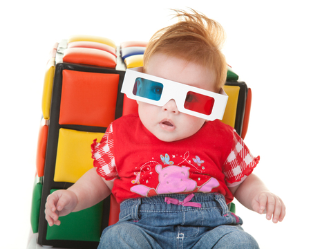 stereoscopic: Funny toddler with stereoscopic glasses for viewing three dimensional.
