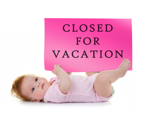 maintains: Female baby holds a signboard that says closed for vacation on white background.