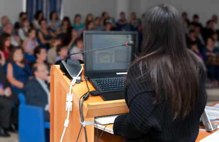slide show: Young business woman during a slide show. Stock Photo