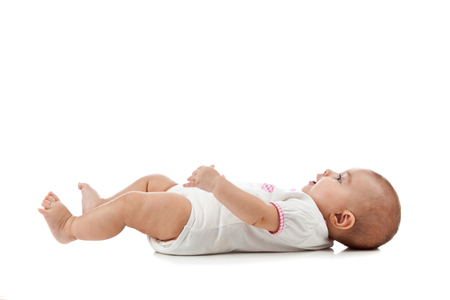 looking at baby: Baby isolated on white background lying on his back Stock Photo