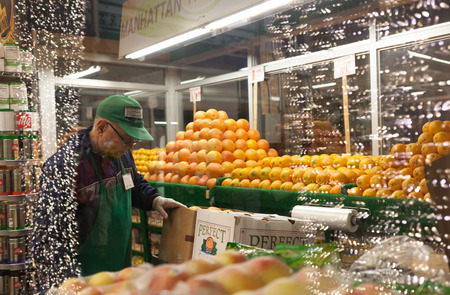 chelsea market: NEW YORK, NY - JULY 12, 2015: Famous market of New York City called Chelsea Market. Supermarket of vegetables and fruits with staff at work.