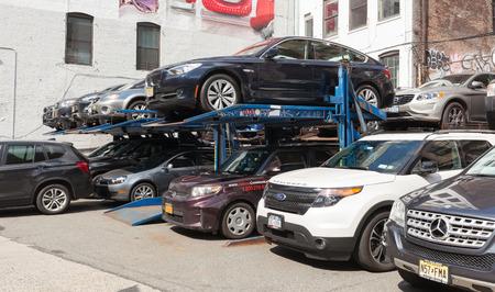 multilevel: New York City, USA - July 07, 2015: A small multi-level parking lot on Lafayette Street below Prince Street in lower Manhattan. Parking space is scarce in Manhattan.