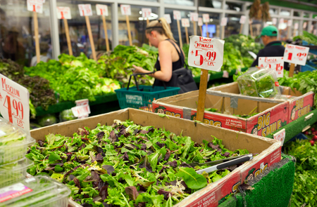 chelsea market: NEW YORK, NY - JULY 12, 2015: Famous market of New York City called Chelsea Market. Supermarket of vegetables and fruits with customers while doing their shopping.