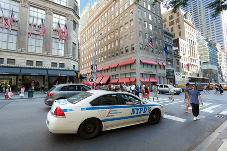 federal police: NEW YORK CITY , USA - JULY 07, 2015: NYPD car in Manhattan; established in 1845, NYPD is the largest municipal police force in the United States. Editorial