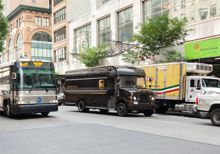 NEW YORK CITY , USA - JULY 07, 2015: UPS truck in Manhattan. United Parcel Serviceis the largest shipment and logistics company in the world.