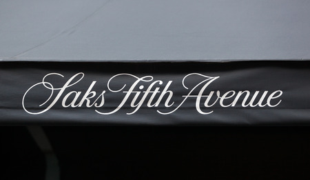 christmas in july: NEW YORK CITY, NY, USA - JULY 07, 2015: Saks Fifth Avenue awning during the Christmas Holiday season. This is the flagship store of the luxury retailer located on 5th Ave. in Manhattan.