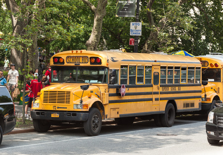 bus background: NEW YORK CITY, NY, USA - JULY 07, 2015: School bus in Manhattan. NYC has the largest school transportation department in the country.
