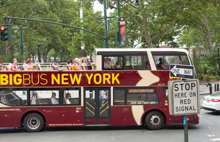 places of interest: NEW YORK CITY, NY, USA - JULY 07, 2015: Big Bus with tourists in Manhattan. Big Bus sightseeing tour is created around a thoughtfully designed route that takes you to key places of interest.