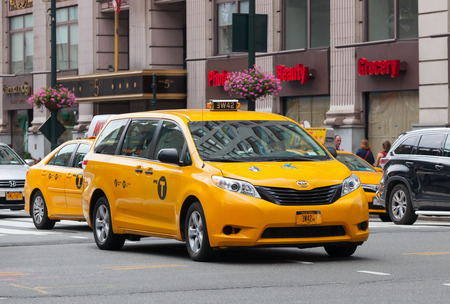 taxicabs: NEW YORK CITY, NY, USA - JULY 07, 2015: Special yellow cab for disabled in Manhattan, NYC. The taxicabs of New York City are widely recognized icons of the city.