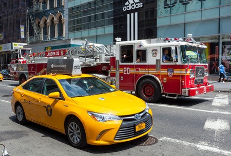 taxicabs: NEW YORK CITY, NY, USA - JULY 07, 2015: Rare image of overlay with FDNY firetruck and yellow cab in Manhattan. The taxicabs and FDNY of New York City are widely recognized icons of the city.