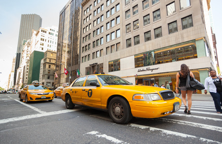 taxicabs: NEW YORK CITY, NY, USA - JULY 07, 2015: Yellow cabs in Manhattan near the stores Salvatore Ferragamo. The taxicabs of New York City are widely recognized icons of the city. Editorial