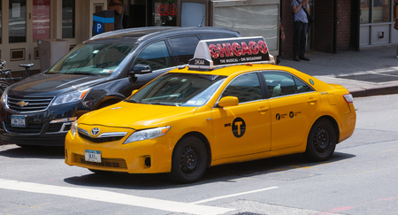 taxicabs: NEW YORK CITY, NY, USA - JULY 07, 2015: Yellow cabs in Manhattan, NYC. The taxicabs of New York City are widely recognized icons of the city.