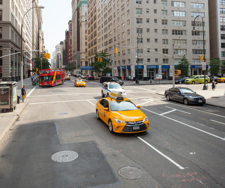 NEW YORK CITY, NY, USA - JULY 07, 2015: Yellow cabs in Manhattan, NYC. The taxicabs of New York City are widely recognized icons of the city.