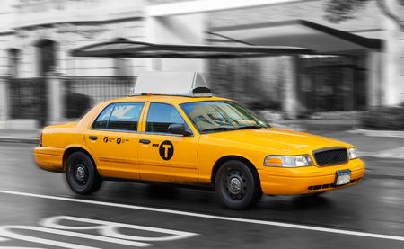 recognized: Yellow cab in Manhattan in a rainy day. The taxicabs of New York City are widely recognized icons of the city. Stock Photo