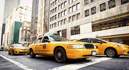 recognized: Yellow cabs in Manhattan, NYC. The taxicabs of New York City are widely recognized icons of the city.