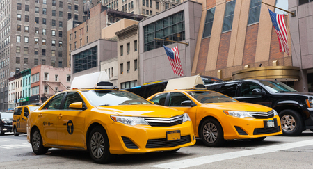 taxicabs: Yellow cabs in Manhattan, NYC. The taxicabs of New York City are widely recognized icons of the city.