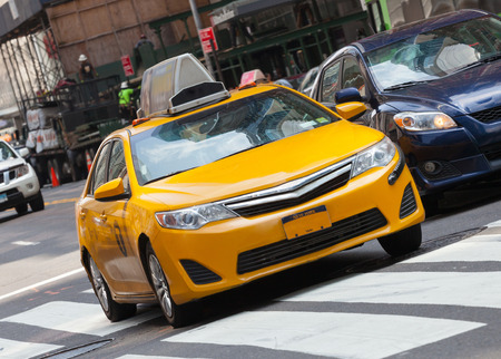 taxicabs: Yellow cab in Manhattan, NYC. The taxicabs of New York City are widely recognized icons of the city.