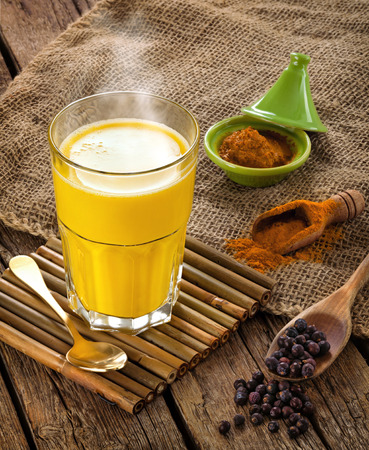 turmeric: Golden Milk, made with turmeric. Remedy for many diseases. Stock Photo