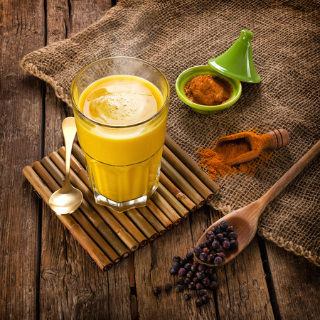 antiseptic: Golden Milk, made with turmeric. Remedy for many diseases. Stock Photo