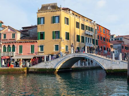 dei: Venice, Italy - February 01, 2015: Croze bridge on Rio dei Tolentini in Venice. Millions of tourists pass through this bridge every year. Editorial