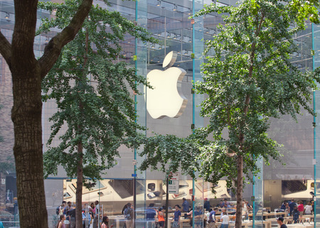 in particular: New York City, NY, USA - July 07, 2015: The Apple store located at the corner of Broadway and 67th street in Manhattan, particular views through the trees.