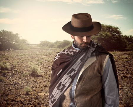 gunfighter: Gunfighter of the wild west with serious and angry expression.