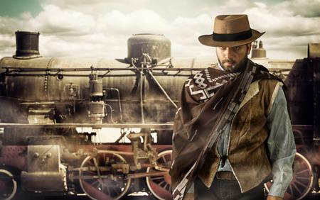 기차역에서 야생 서쪽의 Gunfighter. 스톡 콘텐츠