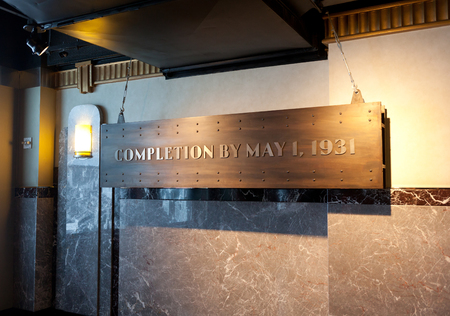 nameplate: New York City, USA - July 10, 2015: Nameplate, in the observatory of the Empire State Building, which says: completion by may 1 ,1931
