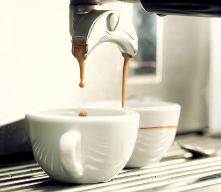 Close up of an espresso machine making a cup of coffee.