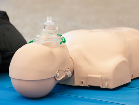 chest compression: Model of dummy used for CPR training with mask. Stock Photo