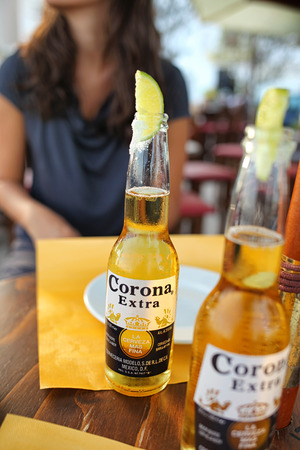 Gallipoli, ITALY - August 13, 2014: Drink at the bar with Corona Extra salt and lime. Corona Extra is produced by Constellation Brands in Mexico and it is the top selling imported beer in the Usa.