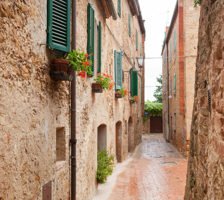 glimpse: Glimpse of old Town Pienza in Tuscany near Siena Stock Photo