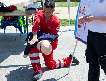 Empoli, Italy - 07 May 2016: The event is run in the square, doctors, nurses and volunteers welcome high school students for a course of first aid, also emergency vehicles on show. Editorial