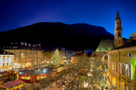 come in: Bolzano, Italy - 09 december 2012: Christmas market in Bolzano with lights and decorations in Walther Square.Every year at Christmas time thousands of tourists come to visit the markets.