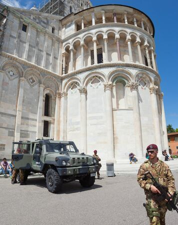 safer: Pisa, Italy - 14 May 2016: View of Square of Miracles at Pisa. Presence of Italian soldiers for the operation Safe Roads as prevention against terrorist attacks.