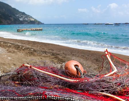 positano: Fishing nets on the beach of Positano, Italy