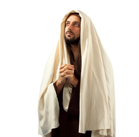 clasped hands: Jesus Christ prays with clasped hands turning our gaze to his father.